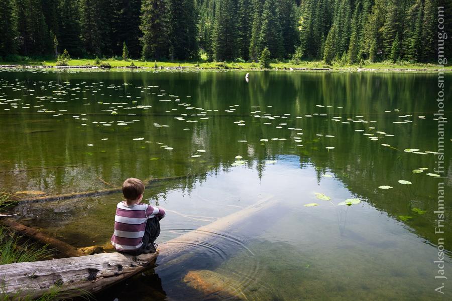 Young hiker beside lake in Gospel-Hump Wilderness, Idaho